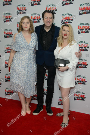 Honey Kinney Ross, Jonathan Ross and Jane Goldman pose for photographers upon arrival at the 'Empire Film Awards' in London