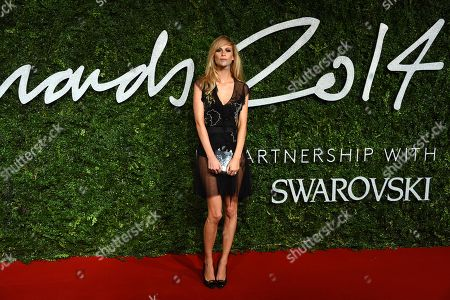 Model Poppy Delevigne poses for photographers upon arrival at The British Fashion Awards 2014, in London