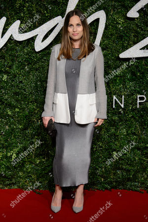Anna Laub poses for photographers upon arrival at The British Fashion Awards 2014, in London