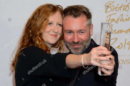 Thea Bregazzi and Justin Thornton of Preen with the Establishment award during the 2014 British Fashion Awards at a central London venue, London