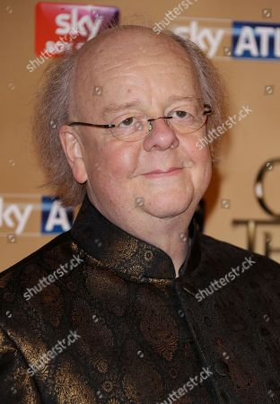 Roger Ashton Griffiths poses for photographers upon arrival at the Tower of London for the world premiere of Game of Thrones, season 5, in London