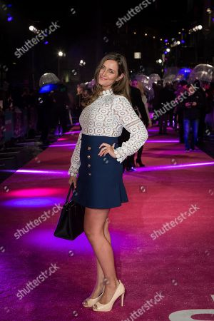 Francesca Newman Young poses for photographers upon arrival at the premiere of the film 'How To Be Single' in London