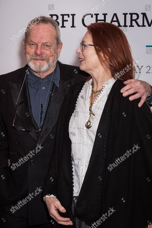 Terry Gilliam and Maggie Weston pose for photographers upon arrival at the BFI Chairman's Dinner in London