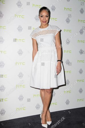 Sarah-Jane Crawford poses for photographers during a photo call at the Jourdan Dunn HTC Event in London
