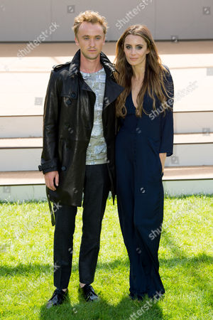 Tom Felton and Jade Olivia arrive for the Burberry Prorsum Menswear collection during London Collections for Men Spring/Summer 2015 in central London, London