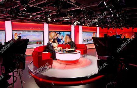 Stock Photo of Ride Along actor and comedian Kevin Hart, right, speaks with BBC Breakfast presenters Susannah Reid and Bill Turnbull, left, after appearing on the morning show at Media City in Manchester