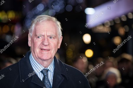 Lawrie McMenemy poses for photographers upon arrival at the world premiere of the film 'The Pass' in London