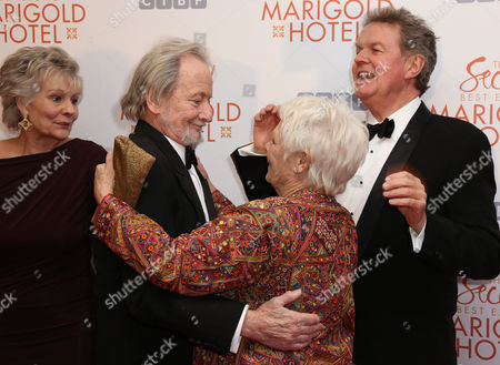 Diana Hardcastle, left looks on as Ronald Pickup greet Dame Judi Dench, alongside Director John Madden, for the World Premiere of The Second Best Exotic Marigold Hotel at a central London cinema in Leicester Square