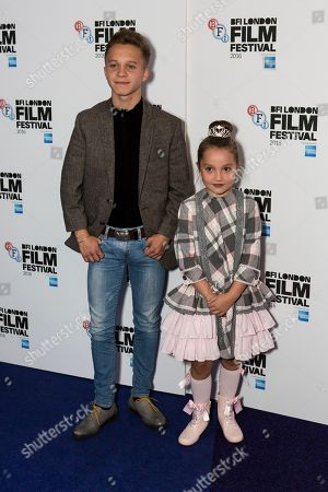 Actors Daniel Huttlestone and Anya McKenna-Bruce pose for photographers on arrival at the premiere of the film 'London Town', showing as part of the London Film Festival in London