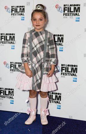 Actress Anya McKenna-Bruce poses for photographers on arrival at the premiere of the film 'London Town', showing as part of the London Film Festival in London