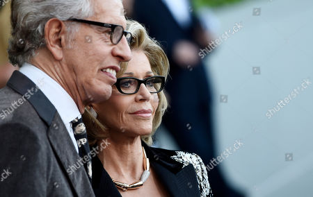 """Actress Jane Fonda and music producer Richard Perry arrive at """"The Champions of Our Planet's Future"""" annual gala, in Beverly Hills, Calif"""