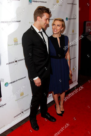 Stock Photo of Hunter Johansson, left, and Scarlett Johansson, right, attend the Champions of Rockaway Hurricane Sandy Fundraiser at Hudson Terrace, in New York