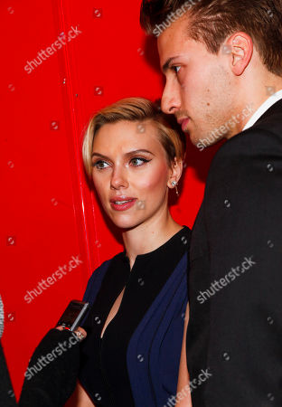 Stock Image of Scarlett Johansson, left, and Hunter Johansson, right, attend the Champions of Rockaway Hurricane Sandy Fundraiser at Hudson Terrace, in New York