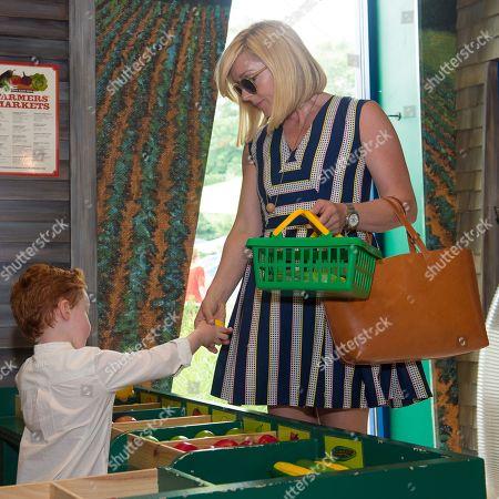 Bennett Robert Godley and Jane Krakowski play at The Children's Museum of the East End's 6th Annual Family Fair in Bridgehampton, in New York