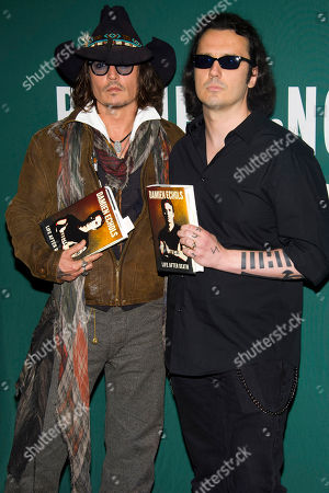 """Johnny Depp, left, and Damien Echols appear at a promotion book event for Echols's biography """"Life After Death"""" at Barnes & Noble bookstore on in New York"""