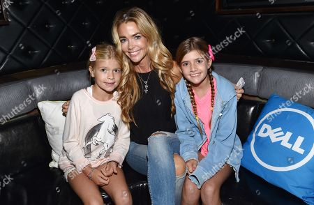Denise Richards, center, Sam Sheen and Eloise Richards attend a private event at Hyde Staples Center hosted by Dell for the Katy Perry concert on in Los Angeles, Calif