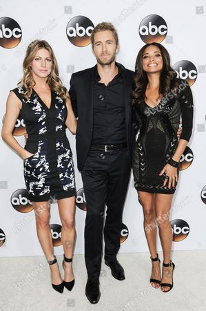 From left, Jes Macallan, Brett Tucker, and Rochelle Aytes arrive at the Disney/ABC Television Group 2015 Winter TCA Party, in Pasadena, Calif