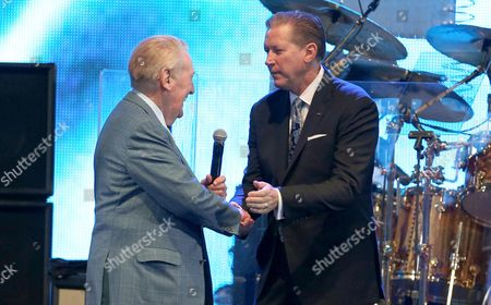 Honoree Vin Scully, left, and Orel Hershiser speak at the Los Angeles Dodgers Foundation Blue Diamond Gala at Dodgers Stadium, in Los Angeles
