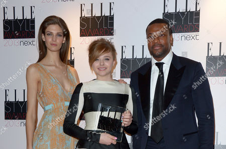 Kendra Spears, left, and Chris Tucker, right, pose with Chloe Moretz, winner of the Next Future Icon award, at the ELLE Style Awards at the Savoy Hotel, in London