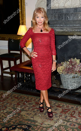 Sue Vanner poses at Everything or Nothing - The Untold Story of 007 After Party at Odeon West End on in London