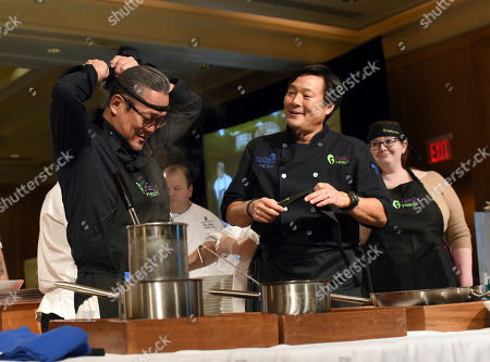 Iron Chef Morimoto, left, and chef Ming Tsai, right, Family Reach National Advisory Board President, prepare a dish at Family Reach's Cooking Live! charity event, at The Ritz-Carlton New York, Battery Park. The event raises funds to help families facing the daily cost of cancer