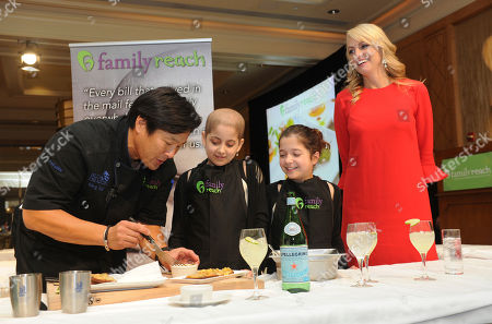 Chef Ming Tsai, Family Reach National Advisory Board President, twins Olivia and Sabrina Lorusso, and Carla Tardif, CEO, Family Reach, left to right, attend Family Reach's Cooking Live! charity event, at The Ritz-Carlton New York, Battery Park. The event raises funds to help families facing the daily cost of cancer