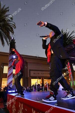 From left, Disney stars Christopher Massey and Kyle Massey perform during the Christmas tree lighting ceremony at Fashion Island, in Newport Beach, Calif