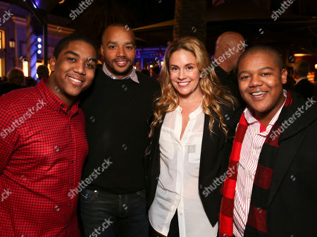 From left, Disney star Christopher Massey, Donald Faison, CaCee Cobb and Disney star Kyle Massey pose during the Christmas tree lighting ceremony at Fashion Island, in Newport Beach, Calif