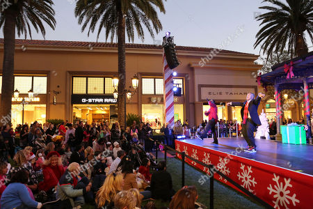 From left, Christopher Massey and Kyle Massey perform during the Christmas tree lighting ceremony at Fashion Island, in Newport Beach, Calif