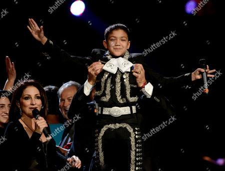 From left, Gloria Estefan and Sebastien De La Cruz onstage at Festival People en Espanol 2013 on at Alamodome in San Antonio, Texas