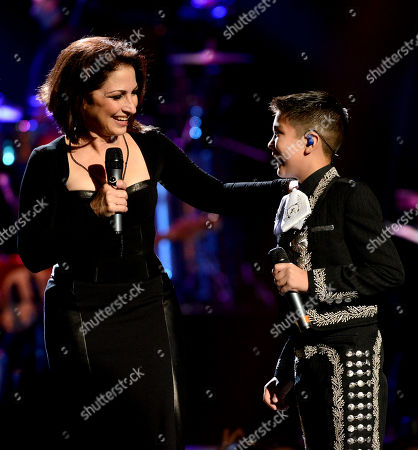From left, Gloria Estefan and Sebastien De La Cruz perform onstage at Festival People en Espanol 2013, on at Alamodome in San Antonio, Texas
