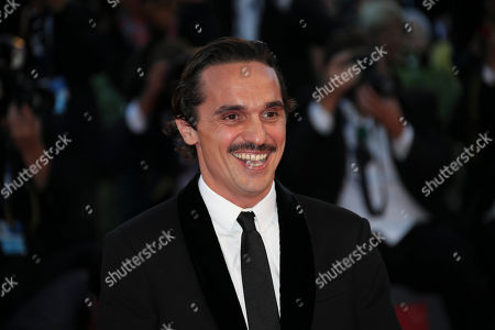 Actor Pier Giorgio Bellocchio poses for photographers on the red carpet for the film Sangue Del Mio Sangue (Blood of my blood), at the 72nd edition of the Venice Film Festival in Venice, Italy, . The 72nd edition of the festival runs until Sept. 12