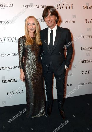 Creative Director of Gucci Frida Giannini and Patrizio di Marco attend Harper's Bazaar Women of the Year Awards 2013 at Claridge's Hotel, in London