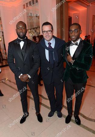 Dumi Oburota, Francois-Henry Bennahmias CEO of Audemars Piguet and Tinie Tempah attend Harper's Bazaar Women of the Year Awards 2013 at Claridge's Hotel, in London