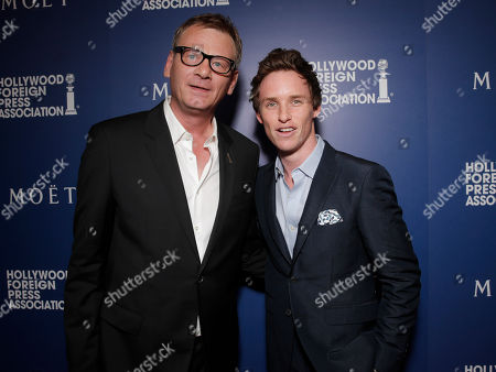 HFPA President Theo Kingma and Eddie Redmayne attend the Hollywood Foreign Press Association's Grants Banquet at the Beverly Hilton hotel, in Beverly Hills, Calif