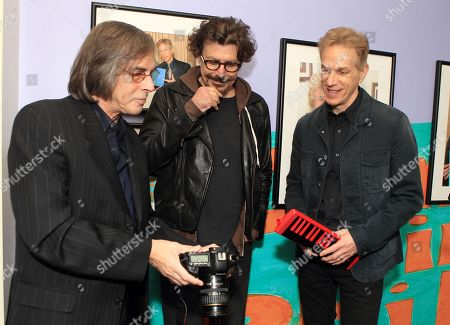 Celebrity photographer Scott Weiner with Eric Bazilian and Rob Hyman of the rock and The Hooters attend the exhibition opening I'm In Philly at the Philadelphia International Airport, in Philadelphia