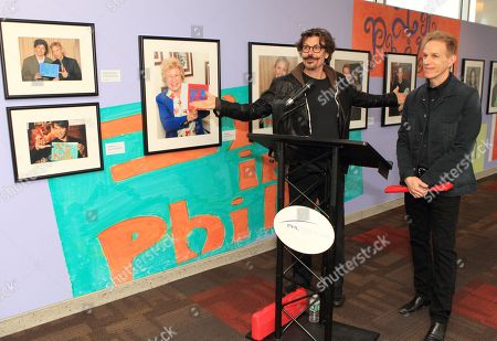 Eric Bazilian and Rob Hyman of the rock and The Hooters attend the exhibition opening I'm In Philly by celebrity photographer Scott Weiner at the Philadelphia International Airport, in Philadelphia
