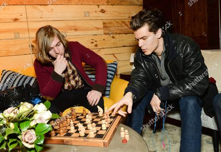 Actors Danny Flaherty, left, and Gus Halper, take a chess break at the Indiewire Photo Studio at Chase Sapphire on Main during the 2016 Sundance Film Festival on in Park City, Utah