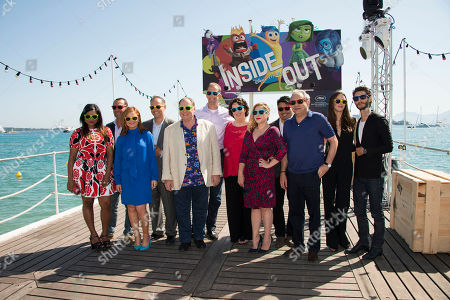 Mindy Kaling, Gilles Lellouche, Amy Poehler, Jonas Rivera, John Lasseter, Pete Docter, Phyllis Smith, Marilou Berry, Ronnie del Carmen, Lewis Black, Charlotte Le Bon and Pierre Niney pose for photographers during a photo call for the film Inside Out at the 68th international film festival, Cannes, southern France