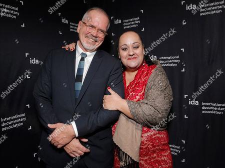 IDA Executive Director Michael Lumpkin and IDA President Marjan Safinia attend the International Documentary Association's 2014 IDA Documentary Awards at Paramount Studios on in Los Angeles