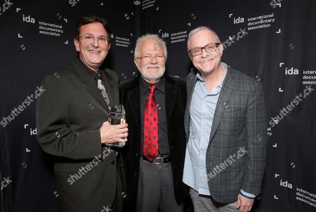 """Stock Image of Neal Baer (right) presents the Humanities Award Winner for """"Limited Partnership"""" to Director Thomas Miller with film subject Tony Sillivan at the International Documentary Association's 2014 IDA Documentary Awards at Paramount Studios on in Los Angeles"""