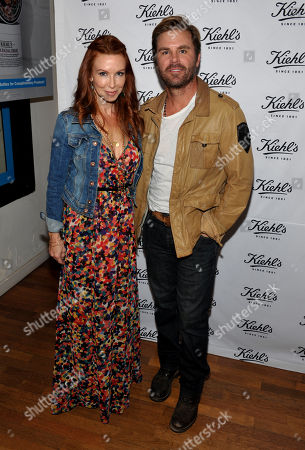 Producer Challen Cates, left, and actor Aaron McPherson attend Kiehl's Earth Day Celebration with Zachary Quinto and Alanis Morissette at Kiehl's, in Santa Monica, Calif