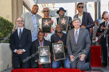 "Stock Image of Mitch O'Farrell, from bottom left, Vincent Herbert, Robert ""Kool"" Bell, Dennis ""DT"" Thomas, Ronald Khalis Bell, George Brown, Jermaine Jackson and Leron Gubler attend a ceremony honoring Kool and The Gang with a star on The Hollywood Walk of Fame, in Los Angeles"