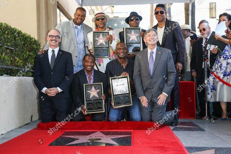 "Stock Picture of Mitch O'Farrell, from bottom left, Vincent Herbert, Robert ""Kool"" Bell, Dennis ""DT"" Thomas, Ronald Khalis Bell, George Brown, Jermaine Jackson and Leron Gubler attend a ceremony honoring Kool and The Gang with a star on The Hollywood Walk of Fame, in Los Angeles"