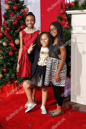 """Nadej Bailey, from left, Marley Taylor, and Marsai Martin arrive at the LA Premiere of """"Almost Christmas"""" at the Regency Village Theatre, in Los Angeles"""