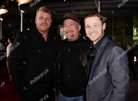 """Actor Michael Cudlitz, left, producer and writer Christopher Chulack, center, and actor Benjamin McKenzie arrive on the red carpet at the premiere of the feature film """"Dark Tourist"""" at the ArcLight Cinemas on in Los Angeles"""
