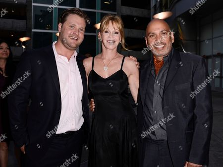 """Actress Melanie Griffith, center, director Suri Krishnamma, right, and an unidentified producer arrive on the red carpet at the premiere of the feature film """"Dark Tourist"""" at the ArcLight Cinemas on in Los Angeles"""