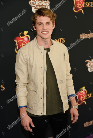 "Jedidiah Goodacre, a cast member in ""Descendants,"" poses at the premiere of the film at Walt Disney Studios Main Theatre, in Burbank, Calif"