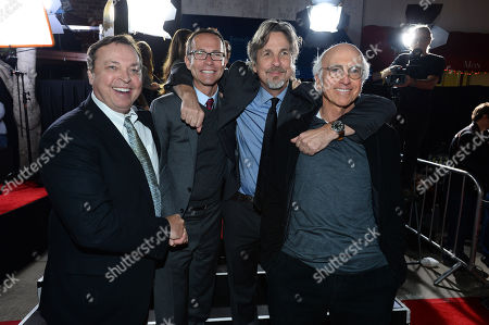 """From left, Bobby Farrelly, Richard Lovett, Peter Farrelly and Larry David arrive at the premiere of """"Dumb and Dumber To"""" at the Regency Village Theatre, in Los Angeles"""
