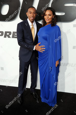 """Ludacris, left, and Eudoxie Agnan arrive at the premiere of """"Furious 7"""" at the TCL Chinese Theatre IMAX, in Los Angeles"""